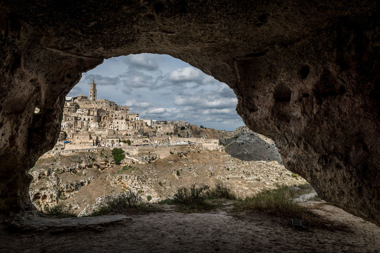 Buildings seen through arch at sassi di matera