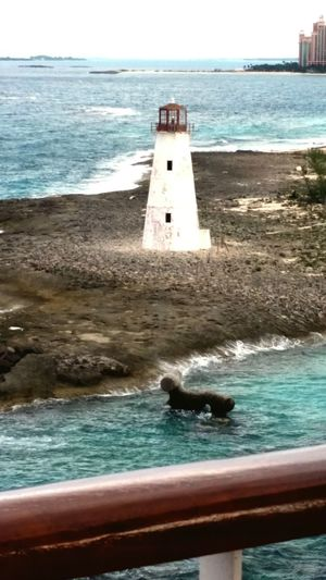 Lighthouse Vacations Travel Destinations Water No People Architecture Outdoors Nature City Scenics Tranquil Scene Bahamas Nassau, Bahamas Waterfront Beachview Awe Rural Scene Tropical Climate Vacations Tranquility Remote /.\ ❤ Backgrounds Cruiseships EyeEmNewHere