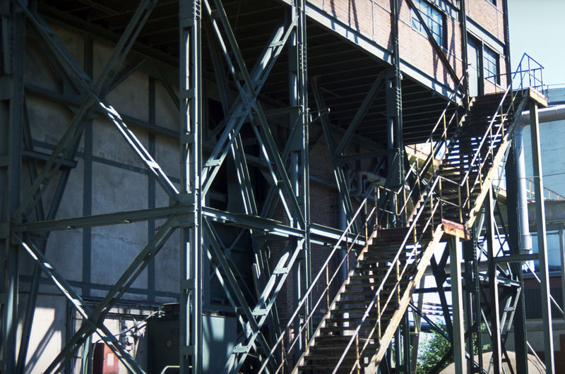 Low angle view of crane in building