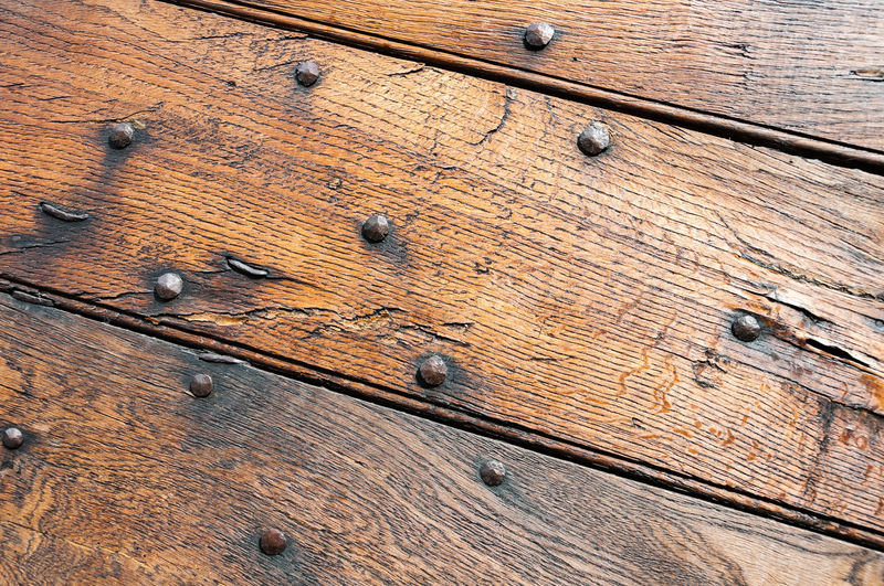 Wooden panels and boards of a rural house, Italy. Wood - Material Full Frame No People Brown Backgrounds Textured  Close-up Metal Pattern Plank High Angle View Day Wood Grain Old Wood Nail Kitchen Utensil Eating Utensil Indoors