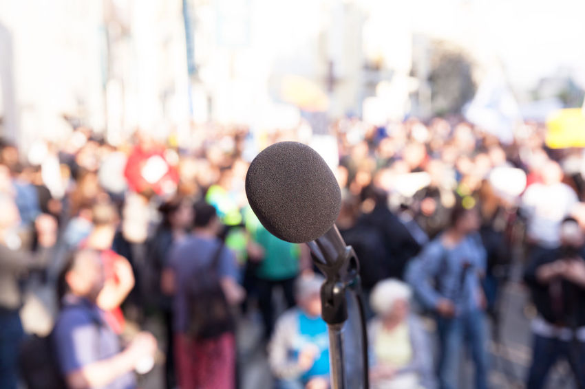 Demonstration. Street protest. Political rally. Event Meeting Protest Street Protest Audience Auditorium Convention Crowd Demonstration Elections Group Large Group Of People Mass Men Microphone Outdoors People Political Political Rally Politics Public Rally Real People Women