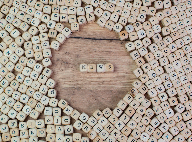 News name in letters on cube dices on table Business Cube Letters Office Read Subscribe Text Wooden Table Word Article Communication Concept Flat Lay Information Journalism Keyword Label Macro Message News Newsletter Occupation Press Releases Report