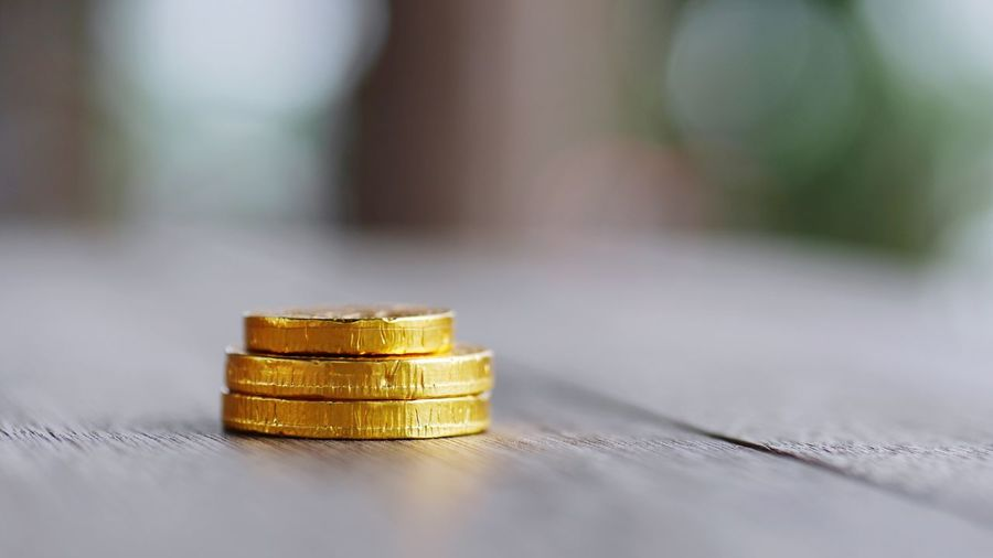 Golden coins are on the wood table. Cryptocurrency Bitcoin Gold Colored Table Wealth Indoors  Yellow Gold Coin Day Close-up Stack No People Savings