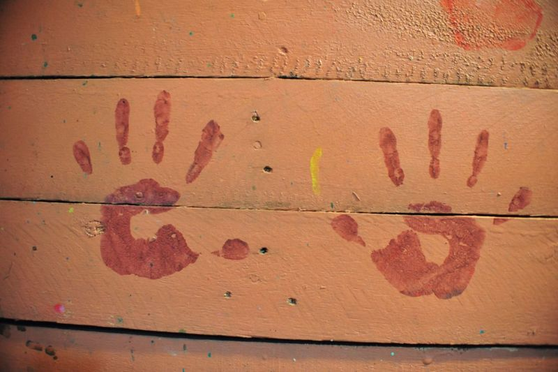 Close-Up Of Hand Prints On Wall