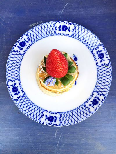 High angle view of strawberry pancake served on table