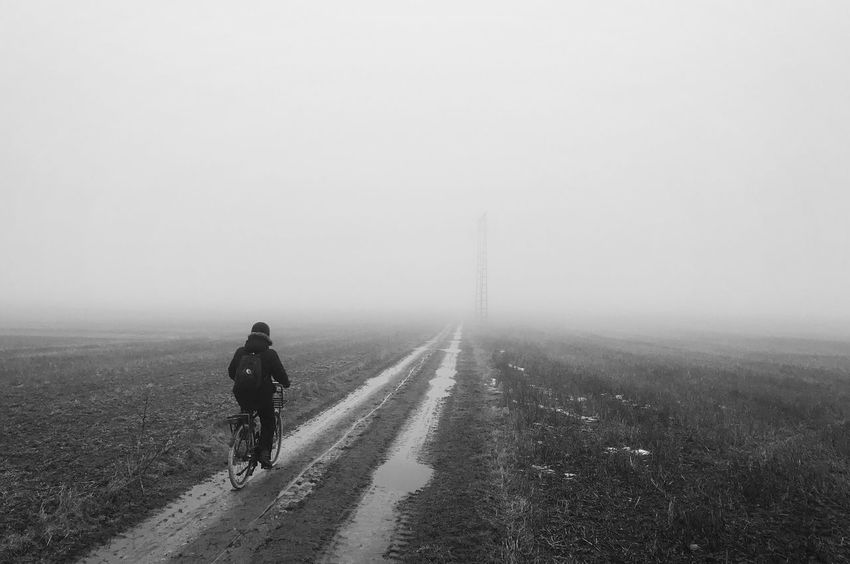 Fog Walking The Way Forward Landscape Rear View Weather Field Nature One Person Winter Beauty In Nature Cold Temperature Sky People Outdoors