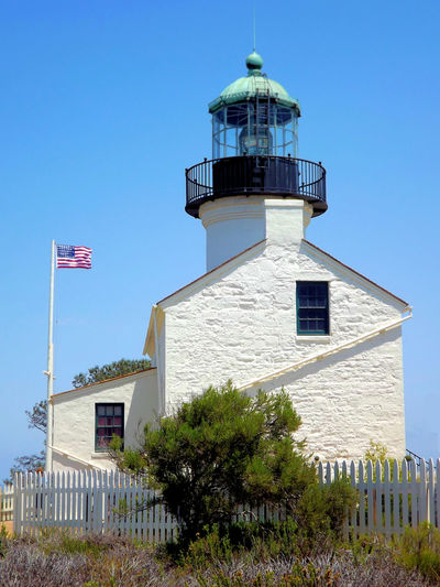 Point Loma Historical Lighthouse and the current Coast Guard Lighthouse. San Diego, California, America's Finest City. Lighthouse, Beacon, Light, Guide, Tower, Warn, Point Loma Lighthouse, Lamp, Lantern, Prism, Lens, Spiral Staircase, Light Tower, Hawk, Perch, National Monument, National Park, San Diego, California, Architecture Built Structure Day No People