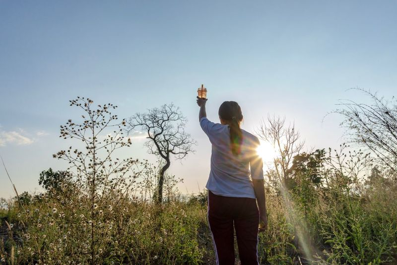 hi tree Sky Standing One Person Three Quarter Length Leisure Activity Casual Clothing Plant Nature Lifestyles Sunlight Outdoors Grass Land Field Clear Sky Holding Human Arm Real People