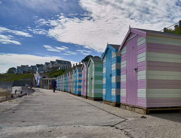 A row of pastel coloured beach huts overlooking the sea in Falmouth, Cornwall, UK Beach Huts Bright Colors British Cornwall Daytime Eccentric English Falmouth Huts Quaint  Quirky Summer