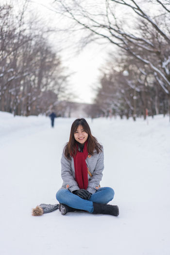 Asian  Japan Japan Photography Japanese  Sapporo,Hokkaido,Japan Sitting Snow ❄ Woman Beautiful Woman Casual Clothing Cold Temperature Day Full Length Hairstyle Leisure Activity Lifestyles Looking At Camera Nature One Person Portrait Real People Sapporo Sitting Smiling Snow Snowing Tree Warm Clothing Winter Young Adult Young Women