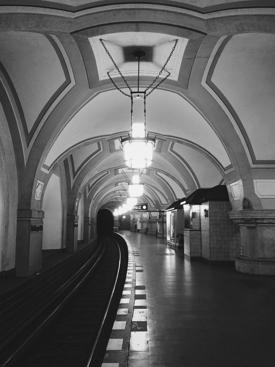 arch, transportation, the way forward, rail transportation, built structure, indoors, architecture, illuminated, railroad station, real people, travel, public transportation, railroad track, one person, day, people