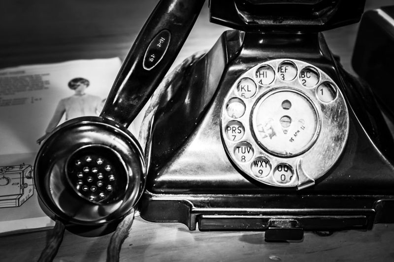 You have probably been talking for a while already on a mobile phone whereas on this you'd still be dialling the number... provided you didn't have to first look it up! Retro Styled Indoors  Telephone Landline Phone Close-up Technology Number No People Communication Still Life Nostalgia Antique Connection Rotary Phone Table Focus On Foreground History The Past Analog