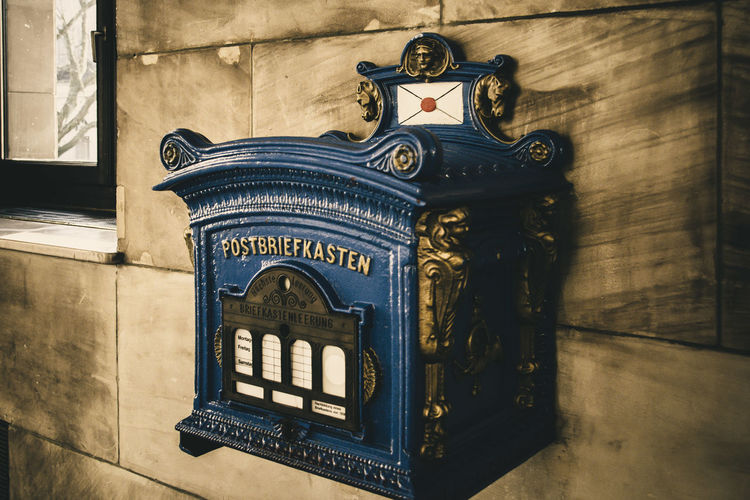 Close-up of mailbox on tiled wall