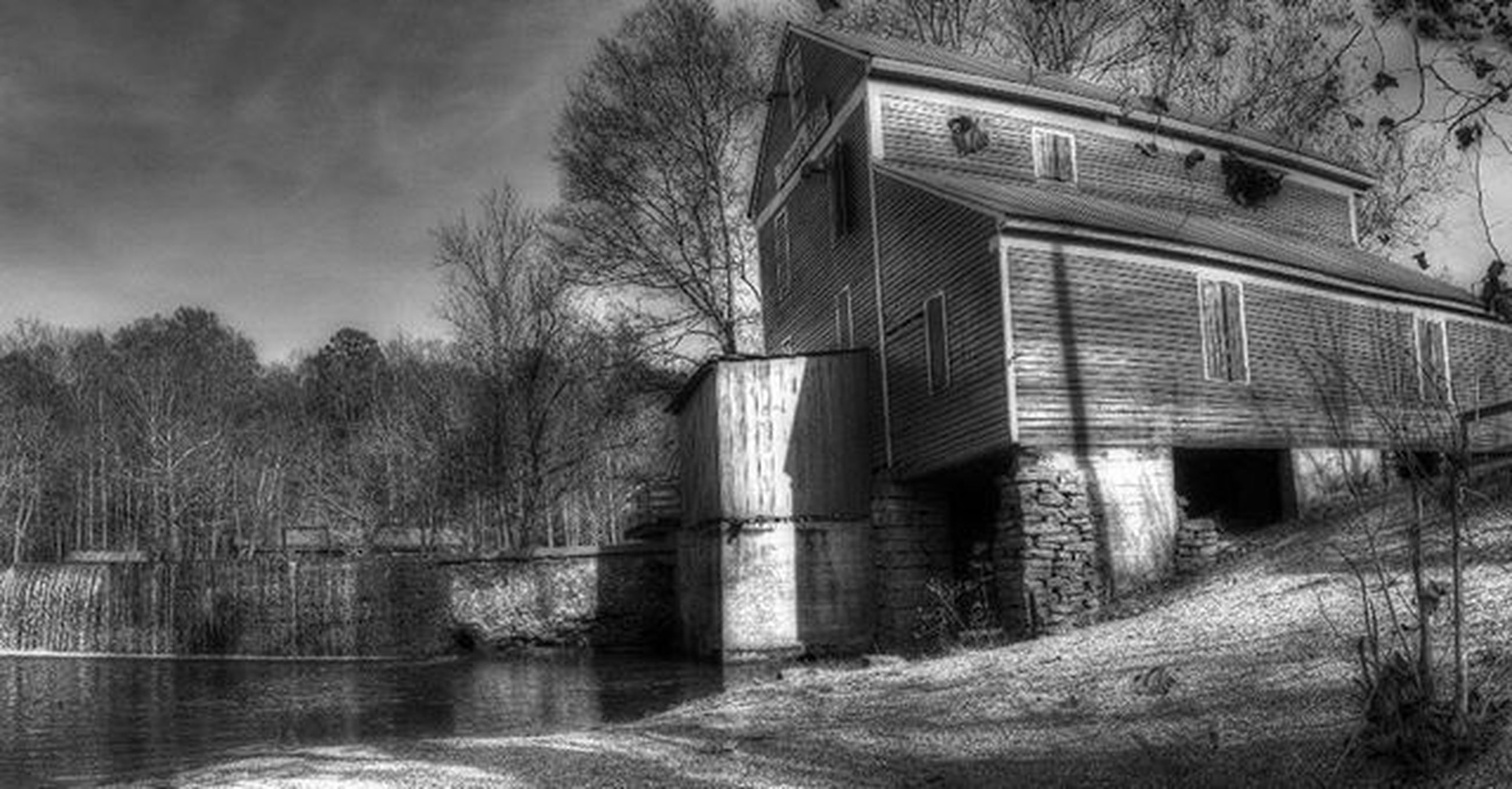 architecture, built structure, building exterior, tree, water, reflection, river, connection, sky, bridge - man made structure, waterfront, house, bare tree, old, no people, outdoors, bridge, abandoned, nature, day