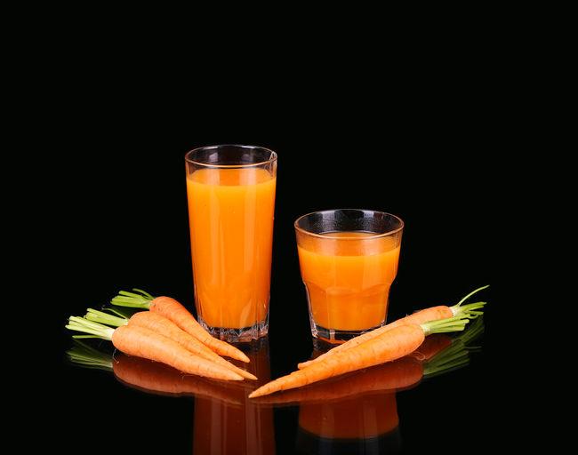 Close-up of orange juice against black background