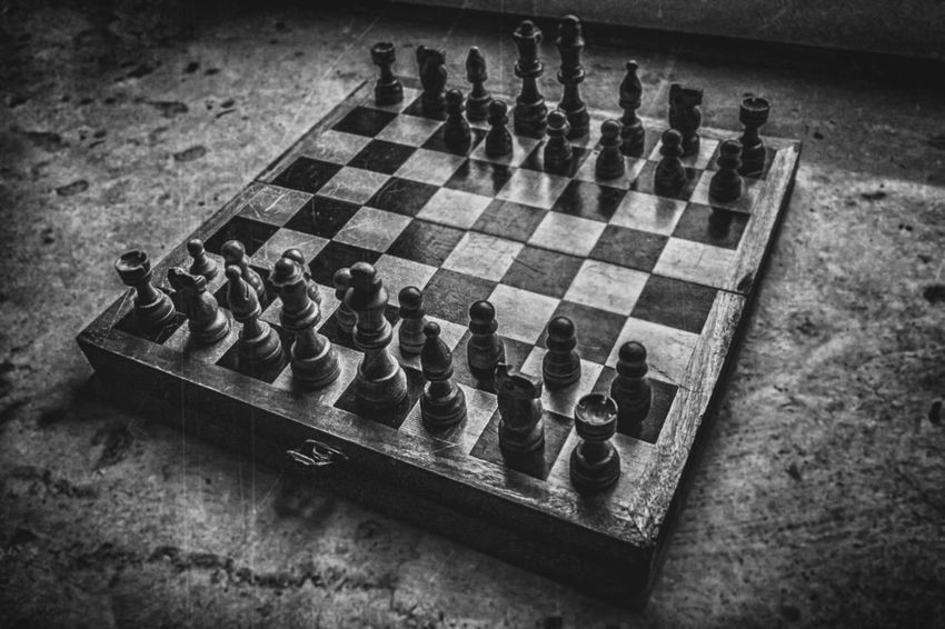 Absence Arrangement Board Game Challenge Checked Pattern Chess Chess Board Chess Piece Competition Competitive Sport Day Decisions High Angle View Indoors  Intelligence King - Chess Piece Knight - Chess Piece Leisure Activity Leisure Games No People Pawn - Chess Piece Queen - Chess Piece Skill  Sport Strategy