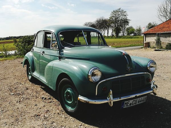 Transportation Cloud - Sky Rural Scene Day Sky No People Outdoors Morris Minor 1000 Oldtimer Old Car Green Color Blue Color HuaweiP9 The Street Photographer - 2017 EyeEm Awards Live For The Story