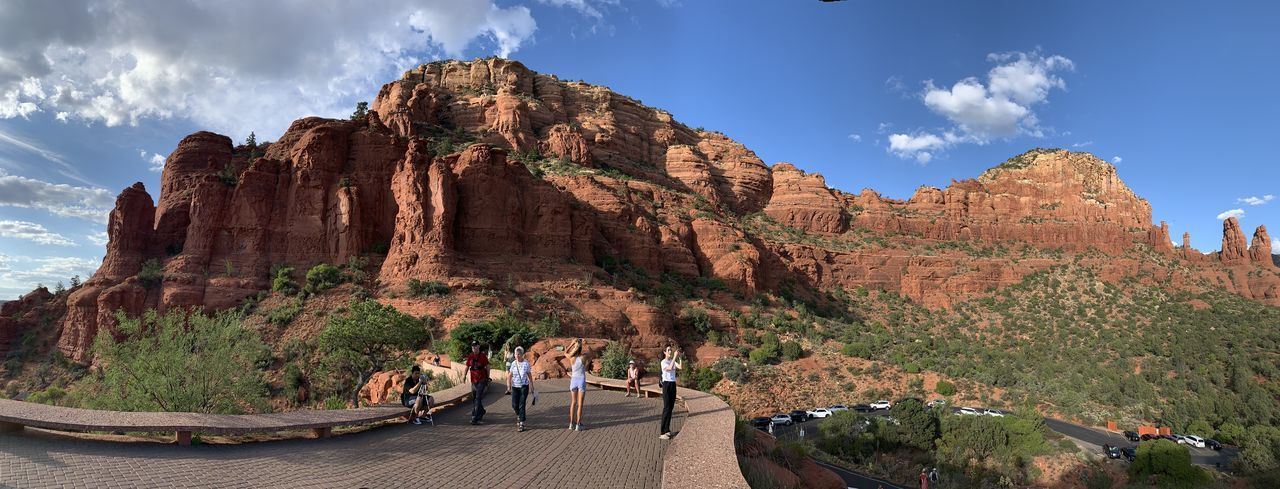 Panoramic view of people on rock formation