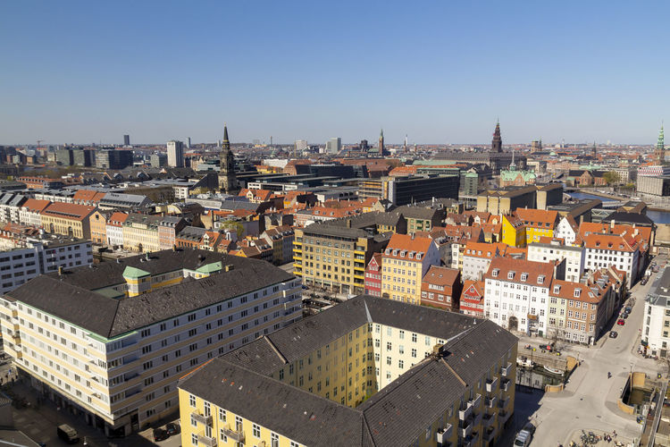 Copenhagen city view from the top Copenhagen Denmark Aerial City Scandinavia View Church Beautiful House Summer Tower Cityscape Danish Day Urban Landscape Skyline Architecture Building Capital Façade Canal Blue Sky Travel Water Europe Street Exterior Horizon Famous Roof Sea Baltic Downtown Panorama Colorful Campanile BIG Green Copy Space