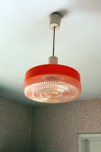 Low angle view of lamp hanging at home