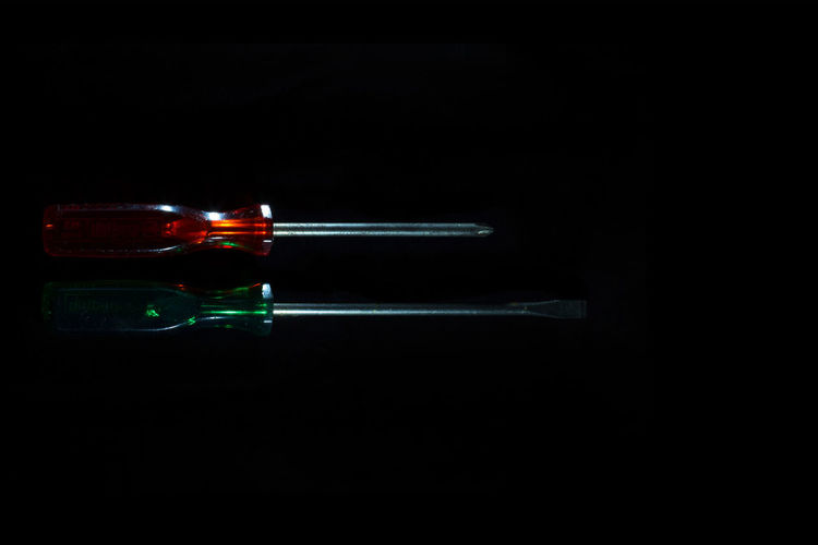 Black Background Dark Green Red Screw Driver Black Close-up Flat Head Illuminated Indoors  No People Philips Head Screw Studio Shot Tools