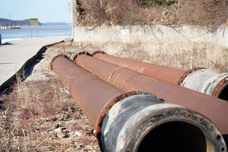 Close-up of metallic pipes outdoors
