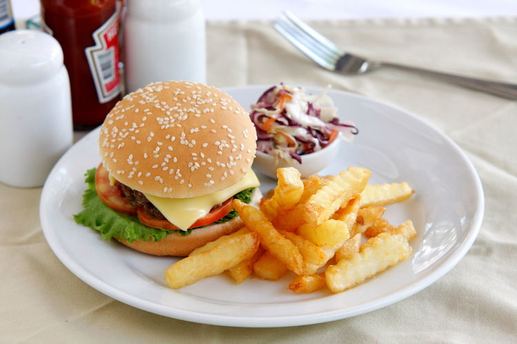 High Angle View Of Hamburger And French Fries In Plate On Table