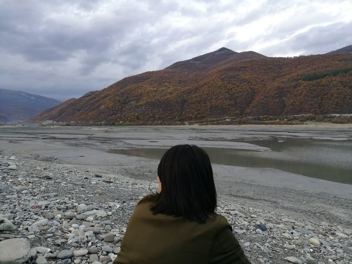 Ananuri Ananuri Georgia Beauty In Nature Cloud - Sky Day Girl Lake Landscape Leisure Activity Lifestyles Mountain Mountain Range Nature One Person Outdoors Real People Rear View River Scenics Sky Tranquil Scene Tranquility Water Women Young Adult