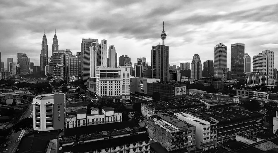 KUALA LUMPUR, MALAYSIA - 1st JANUARY 2016 ; Kuala Lumpur and its surrounding urban areas form the most economically growing region in Malaysia. Downtown Financial District  KL TOWER Architecture Blackandwhite Building Exterior Built Structure Business Finance And Industry Chow Kit City Cityscape Cloud - Sky Downtown District Engineering Klcc Modern Monochrome Outdoors Sky Skyscraper Tall - High Tower Travel Destinations Uptown Urban Skyline
