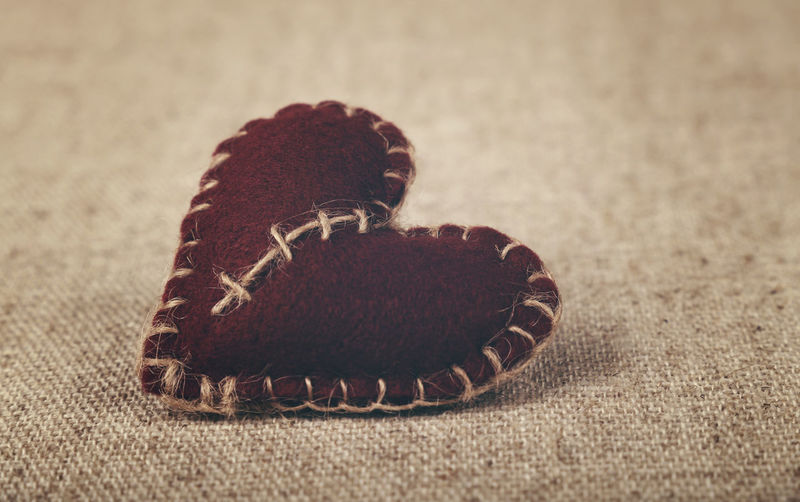 Close-Up View Of Heart Shape Decor On Burlap