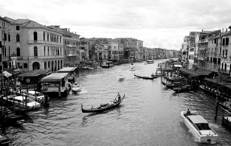Grand canal amidst buildings in city against sky