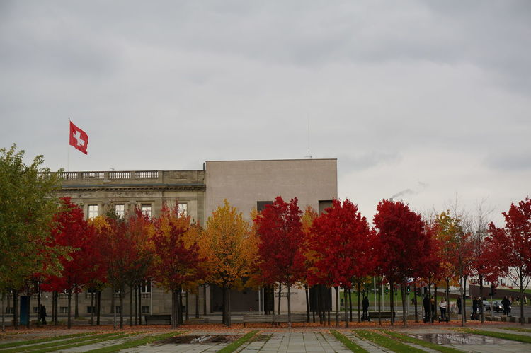 Architecture Autumn Autumn Collection Autumn Colors Berlin Building Exterior Embassy Flag Government Grey Sky Outdoors Politics And Government Red Trees Swiss Embassy Switzerland Trees