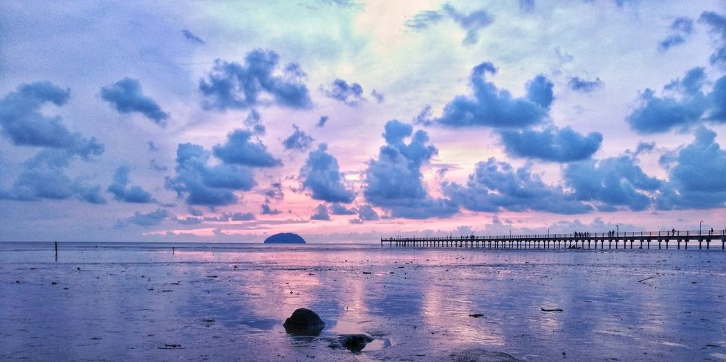 Sunset near Pantai Murni Jetty Nature Beauty In Nature EyeEm Selects Water Sea Beach Sunset Blue Sky Horizon Over Water Cloud - Sky Seascape Low Tide Coastal Feature Romantic Sky Dramatic Sky Island Coast Coastline Calm Shore Rocky Coastline