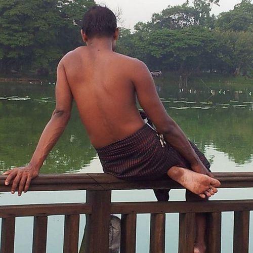 A man fishing/relaxing on the Kandawgyi Lake. Yangon Rangoon Myanmar Burma Kandawgyi Travelshots Everydayasia Everydaylife Everydaymyanmar Peoplewatching Chill Lakeside Travelawesome Travelingourplanet Travelphotography
