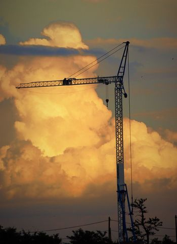 Beauty In Nature Cloud Cloud - Sky Clouds And Sky Construction Construction Site Crane Crane - Construction Machinery Development Evening EyeEm Best Shots EyeEm Gallery Eyyem Growth Industry Low Angle View Nature Orange Color Outdoors Progress Silhouette Sky Strorm Sunset Tall - High