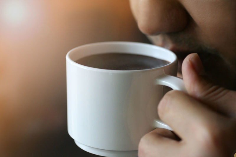 A man drinking a coffee close up Backgrounds Close Up Close-up Coffe Coffecup Coffee - Drink Coffee Cup Cup Drink Drinking Food And Drink Freshness Holding Indoors  Lifestyles Men One Person People Refreshment Tea - Hot Drink
