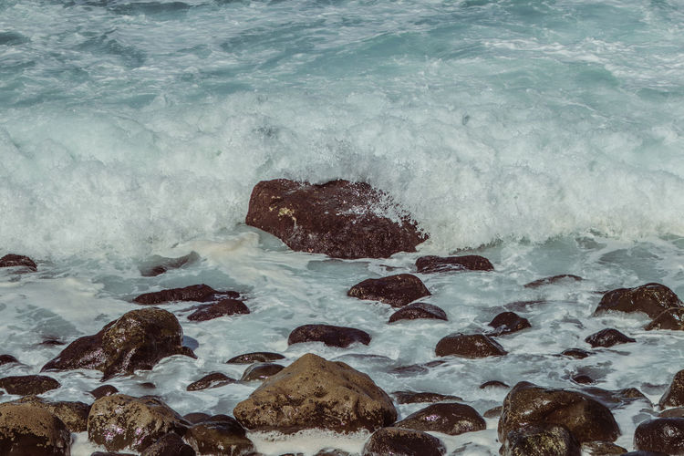 Rock Solid Sea Water Rock - Object No People Beauty In Nature Motion Nature Sport Wave Day Beach Outdoors Aquatic Sport High Angle View Scenics - Nature Power In Nature Breaking Land