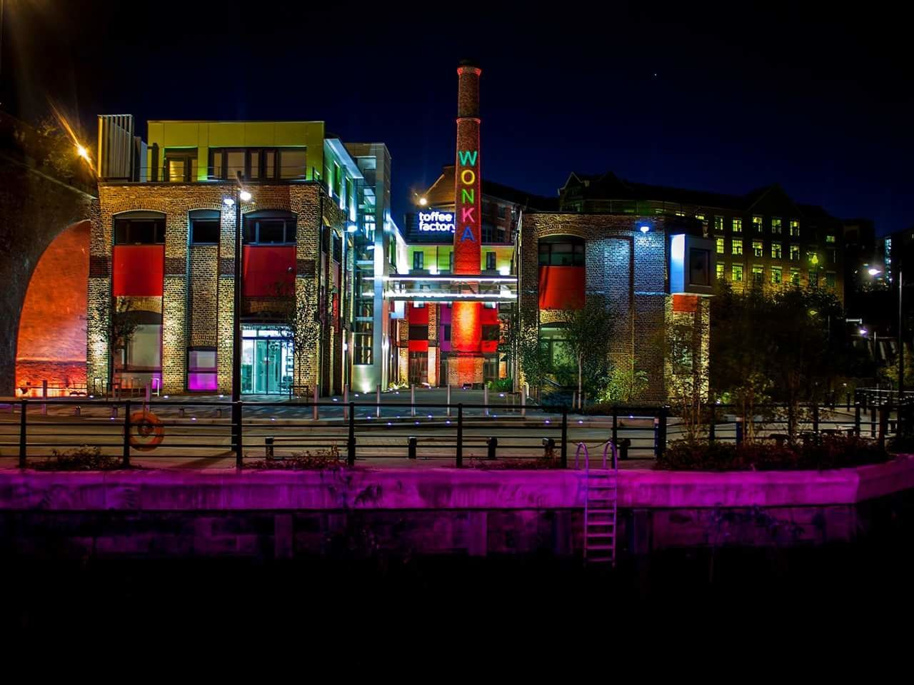 night, illuminated, architecture, building exterior, built structure, city, outdoors, travel destinations, no people, sky, cityscape, neon, modern, multi colored, urban skyline