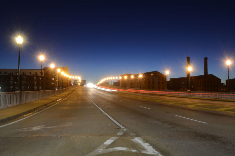 Illuminated Street Light Street Night Road City Transportation Motion Long Exposure Sky Lighting Equipment Architecture Light Trail Speed No People Nature Building Exterior The Way Forward Clear Sky Built Structure Outdoors