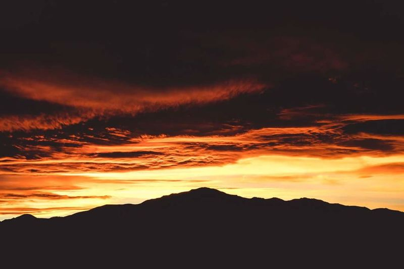 Sunset Silhouette Nature Dramatic Sky Landscape Scenics Beauty In Nature Mountain Tranquility No People Outdoors Cloud - Sky Sky Tranquil Scene Vacations Travel Destinations Multi Colored Sunlight Beauty Tree