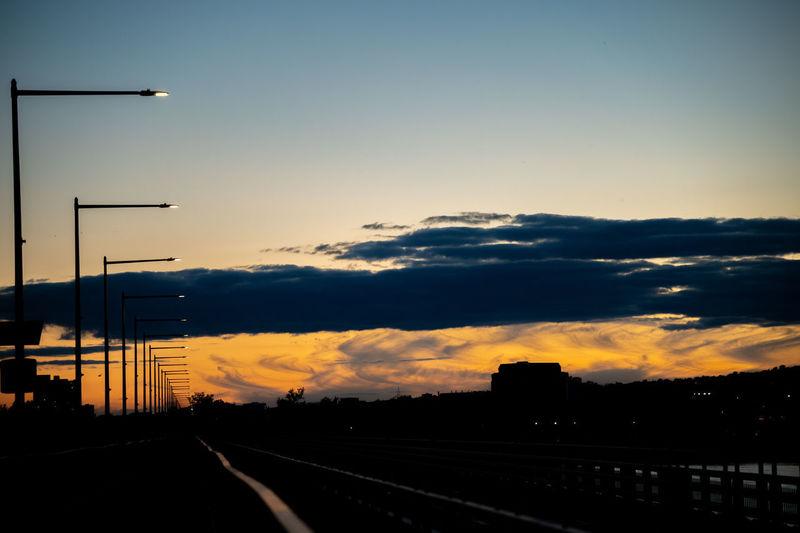 Street against sky at sunset