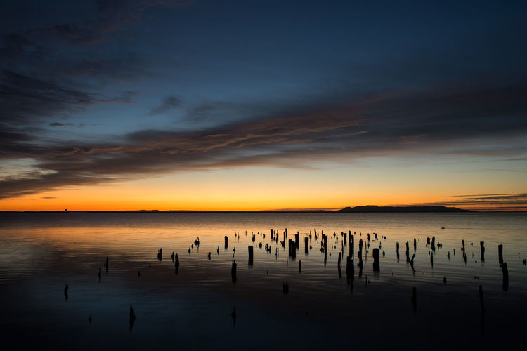 Water Sky Sunset Beauty In Nature Scenics - Nature Sea Cloud - Sky Silhouette Tranquility Reflection Tranquil Scene Waterfront Nature Post Horizon Over Water Wooden Post Idyllic Horizon Orange Color No People
