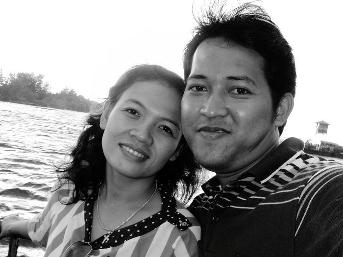 Portrait Of Couple Smiling Against Sea