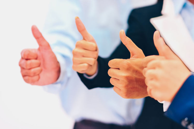 Gesturing Thumbs Up Human Hand Hand Human Body Part Hand Sign Thumb Men Indoors  One Person Business Finger Focus On Foreground Success Human Finger Showing Communication Close-up Business Person Body Part