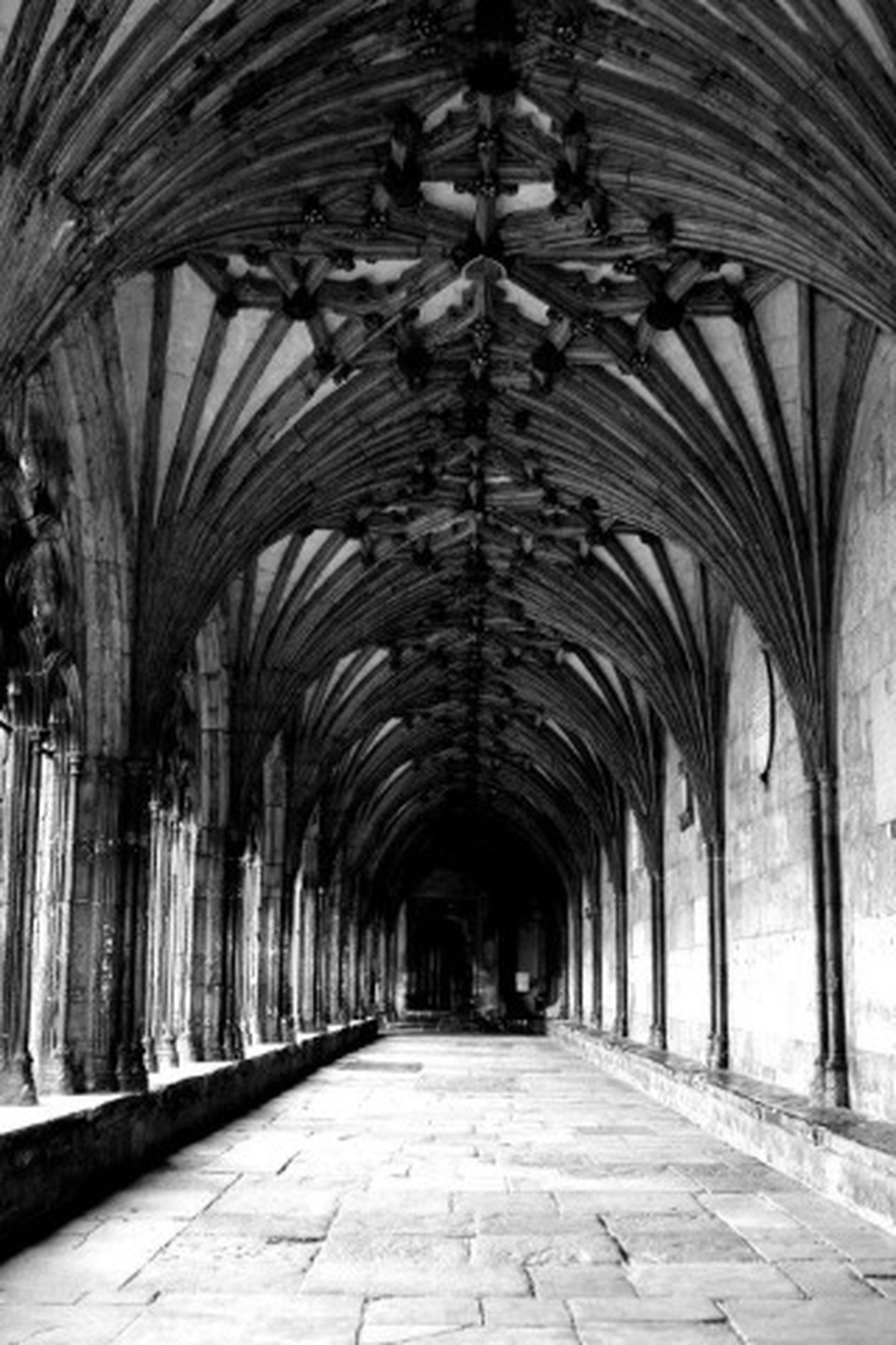 the way forward, arch, indoors, architecture, diminishing perspective, corridor, built structure, ceiling, vanishing point, empty, archway, architectural column, tunnel, walkway, in a row, colonnade, flooring, long, narrow, interior