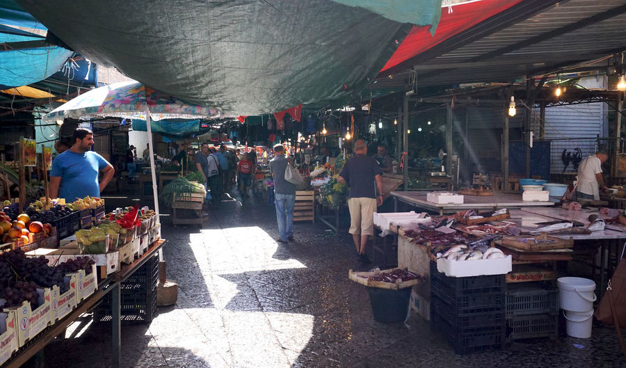 green market in Palermo, Italy Retail  Market Market Stall Choice Business Food And Drink Food For Sale Variation Incidental People Buying Selling Shopping Small Business Sale Vendor Outdoors Street Market Sicily Street Photography Streetphotography Travel Palermo Freshness