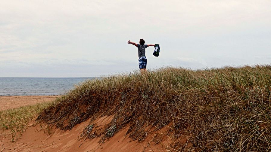 First beach day after winter! - Panmure Island - PEI Arms Outstretched Beach Beachphotography Canada Excitement Freedom Joy Loving Life! Nature Pei Prince Edward Island Sea Sky Standing Summer Water Young Adult