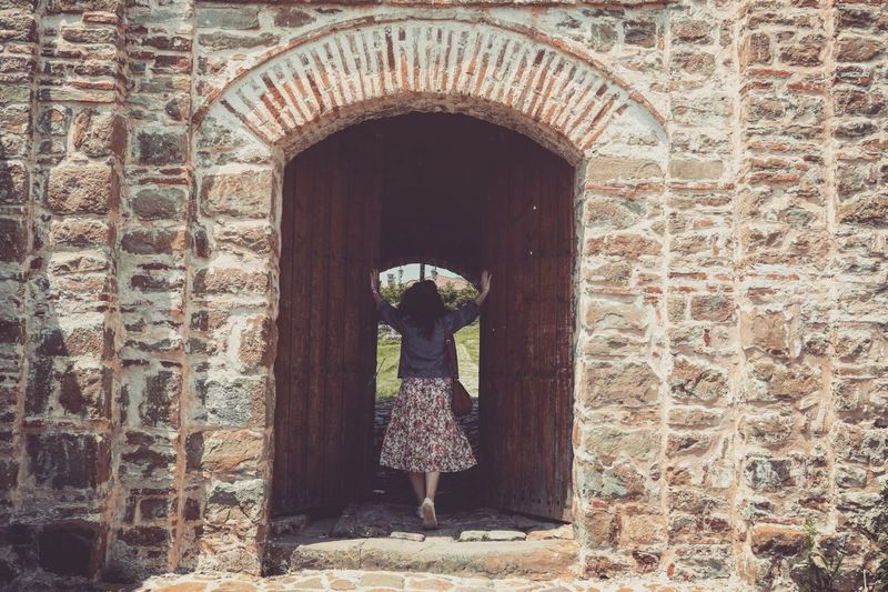 Castle Girl Tourism Exploring EyeEm Best Shots Open Edit Out And About Old Castle Pattern Arch Architecture Historic Entryway Old Ruin Open Door