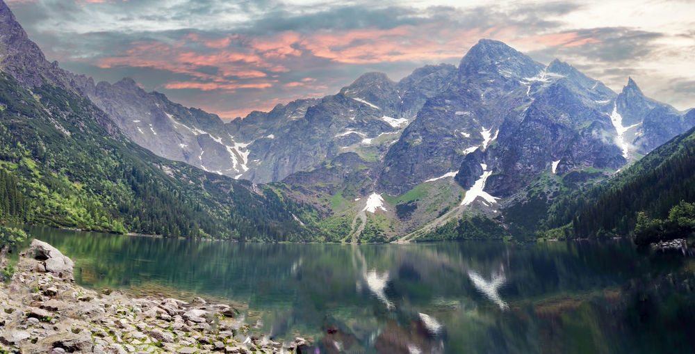 Wide angle shot of misty and rainy view of mountain landscape with dramatic sky in morskie oko