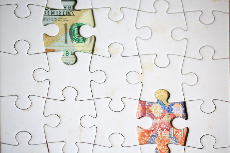 Jigsaw Piece Puzzle  Jigsaw Puzzle Indoors  Large Group Of Objects Leisure Games Male Likeness Currency Money Dollar Chinese USA America Trade War Business Monetary Behind Game Hidden Economic